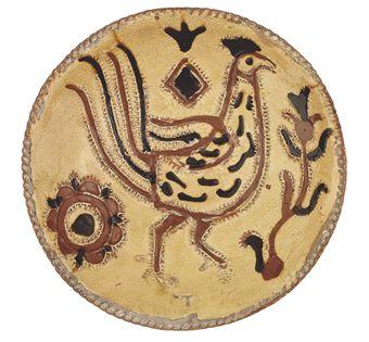 an_english_press-moulded_slipware_dish_circa_1700-1730_probably_staffo_d5323488h